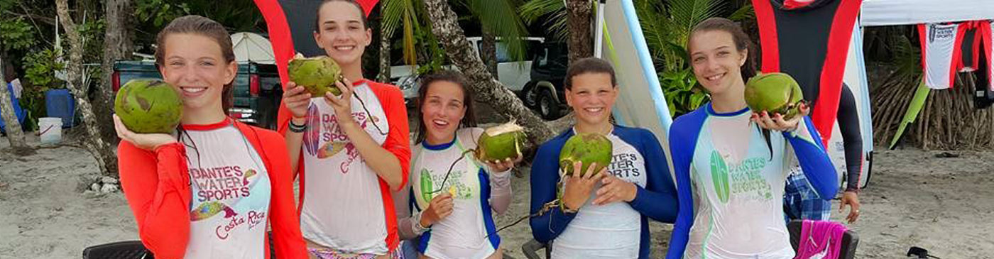 Surfers enjoy local fruits on Manuel Antonio Beach
