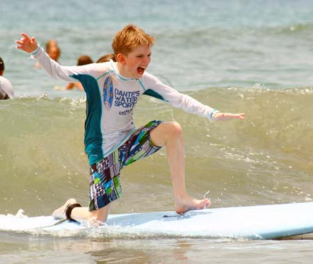 Young boy conquers waves with Costa Rica surfing lessons