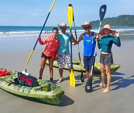Friends explore the coast of Costa Rica in kayaks